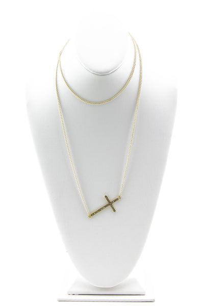 UNEVEN GOLD CROSS NECKLACE