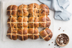 Delicious and decadent Hot Cross Buns with chocolate chips! These buns are subtly spiced and generously studded with chocolate, making them the perfect Easter treats