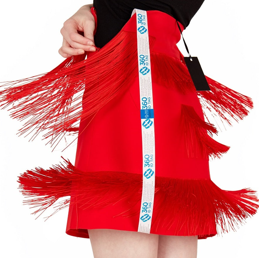 E-commerce return security tag on skirt. Prevent return fraud like wardrobing, wear and return, counterfeit product switches and tag switches. Add return tag to clothing, shoes, accessories to stop fraudulent returns. 360 ID Tag.