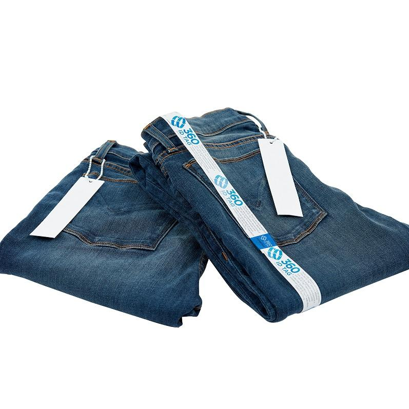 E-commerce return security tag on jeans. Prevent return fraud like wardrobing, wear and return, counterfeit product switches and tag switches. Add return tag to clothing, shoes, accessories to stop fraudulent returns. 360 ID Tag.