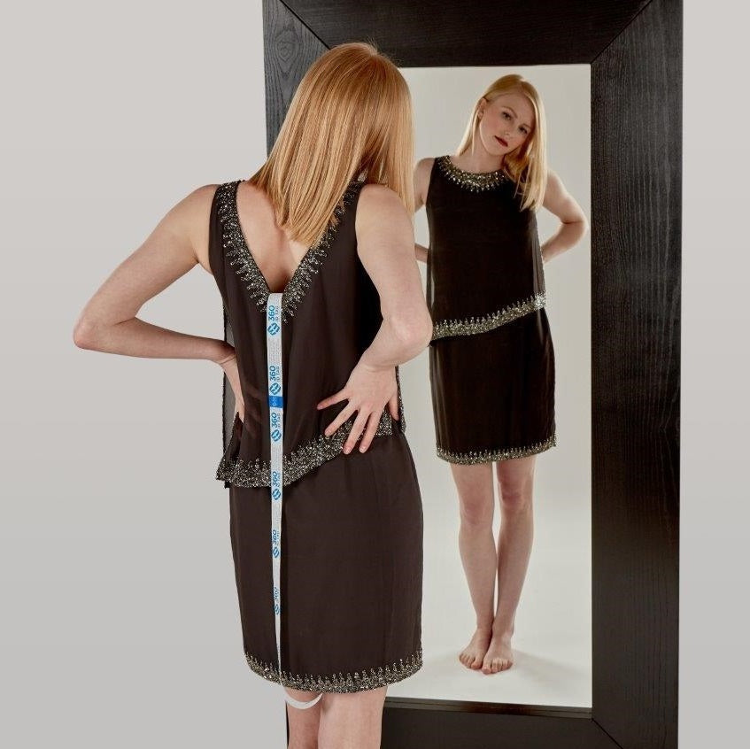 E-commerce return security tag on dress. Prevent return fraud like wardrobing, wear and return, counterfeit product switches and tag switches. Add return tag to clothing, shoes, accessories to stop fraudulent returns. 360 ID Tag.