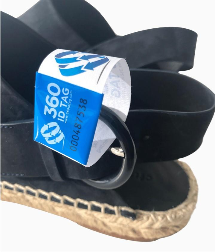 Espadrilles with e-commerce return tag to prevent return fraud like wardrobing, wear and return, counterfeit product switches. 360 ID Tag