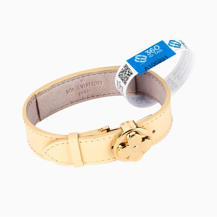Jewelry with e-commerce return tag to prevent return fraud like wardrobing, wear and return, counterfeit product switches. 360 ID Tag