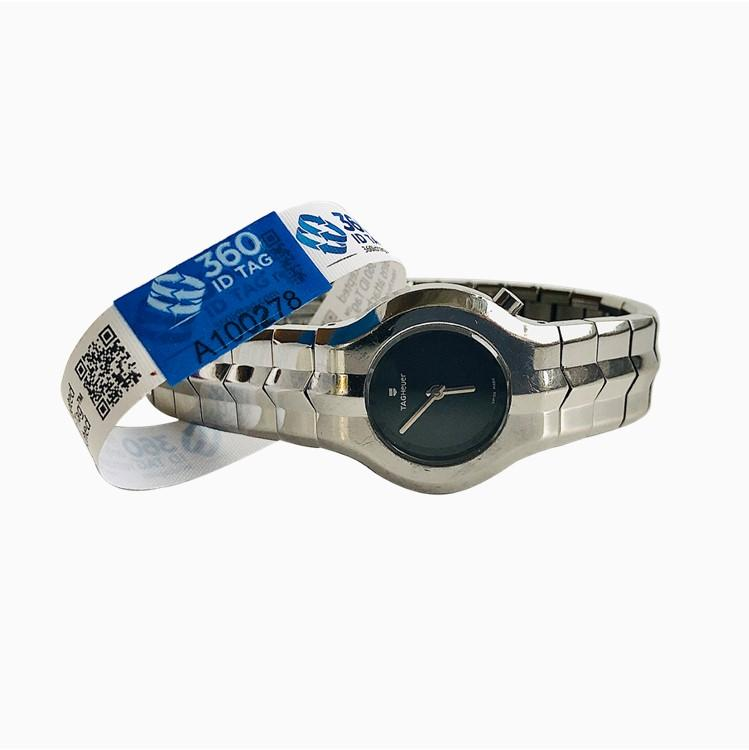Watch with e-commerce return tag to prevent return fraud like wardrobing, wear and return, counterfeit product switches. 360 ID Tag
