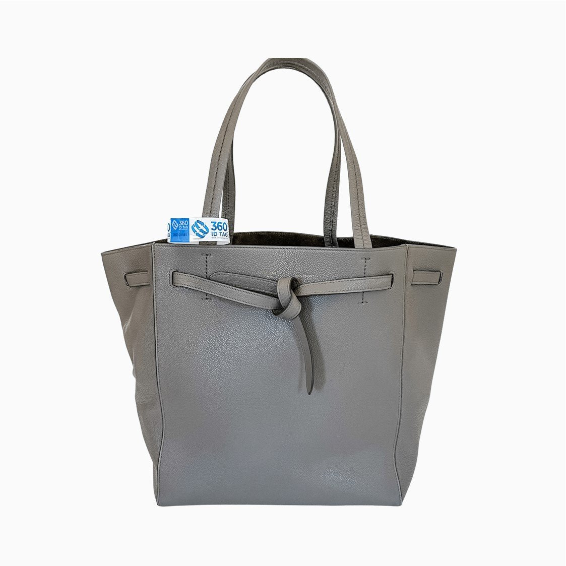 Handbag with e-commerce return tag to prevent return fraud like wardrobing, wear and return, counterfeit product switches. 360 ID Tag