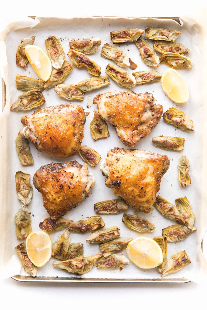 Whole30 + Keto Sheet Pan Greek Chicken Recipe – crispy chicken thighs in a greek marinade + artichoke hearts