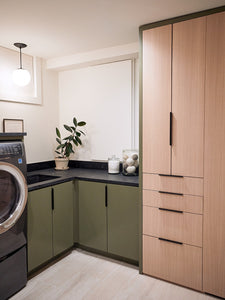 Clever Built-Ins Hide All the Clutter in This Basement Laundry Room