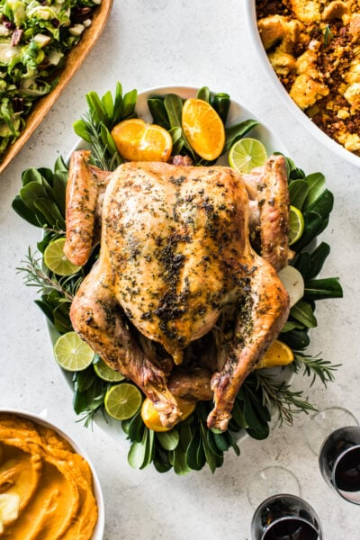 A juicy and tender herb roast turkey recipe perfect for the best Friendsgiving celebration! It's quick brined for only 4 hours (no need to brine overnight) and slathered in fresh herb butter made from sage, thyme, rosemary, cilantro, parsley and...