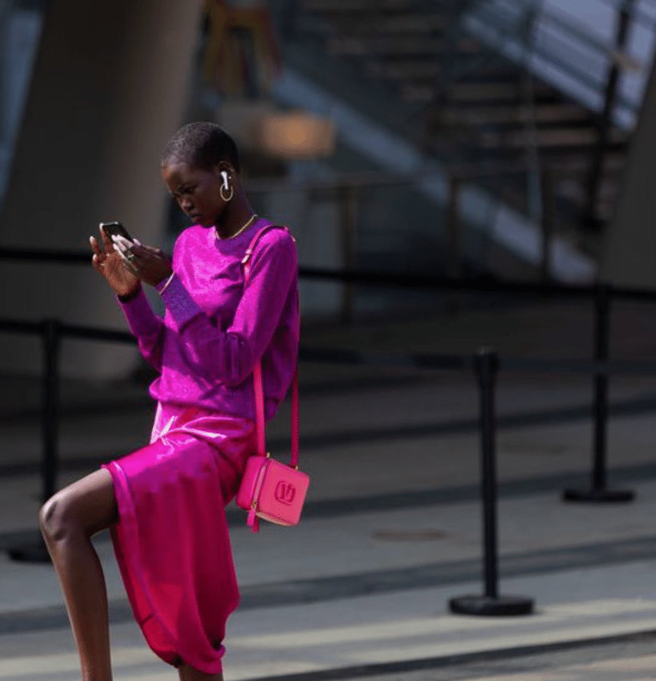 *Image above of supermodel Adut Akech Bior, looking impossibly chic while possibly pausing to lock in an Amazon Prime deal, which today includes a discount on the Apple Airpods she's wearing above.