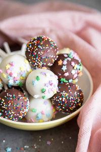 Cake Pops are the cutest desserts for any celebratory occasions! These pretty cake pops are made with vanilla cake mixed with cream cheese frosting, covered with melted chocolate and festive sprinkles.