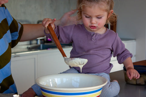 baking, mixing batter for hotcakes