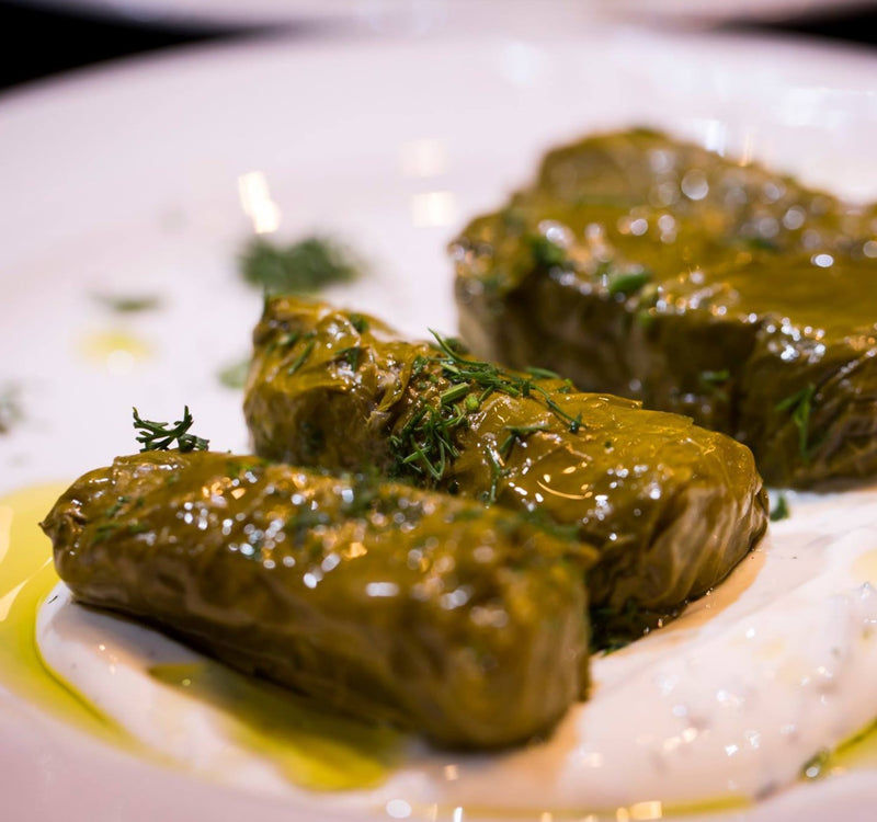 Homemade organic dolmades / dolmadakia - stuffed vine leaves by Grecian Purveyor.  High quality Greek foods and products in Australia.