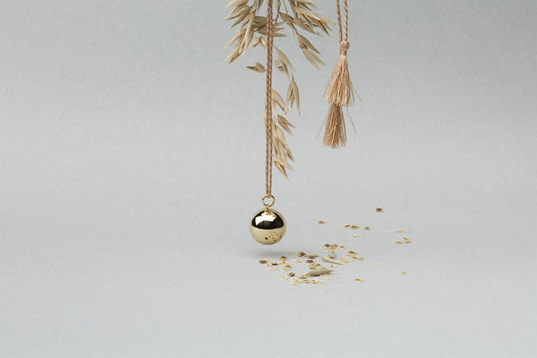 Chime Ball Necklace by Ilado Paris