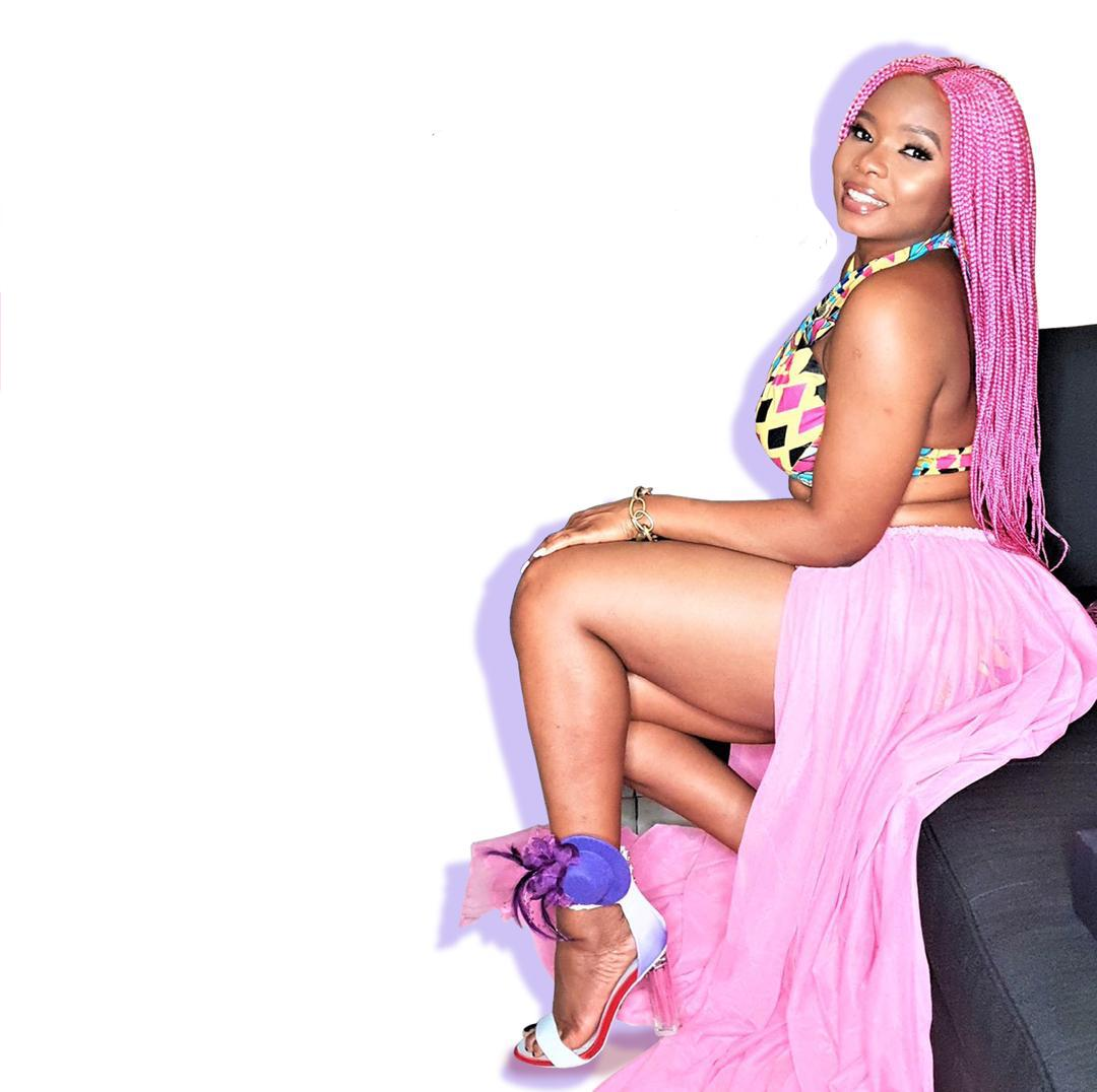 Yemi Alade Looking Pinky Flashy in Randivie Down Town Purple Heels