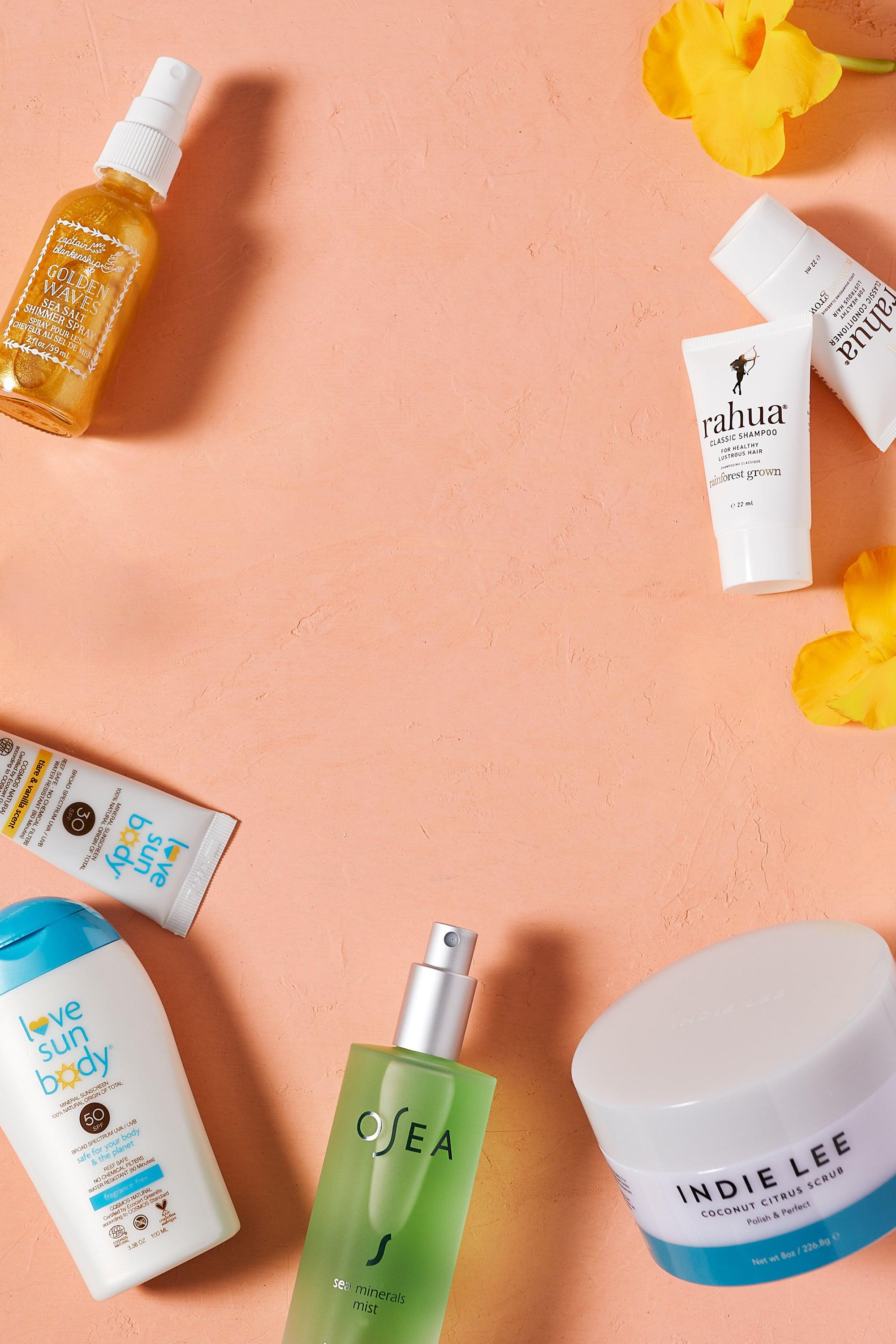 The August Detox Box featuring Indie Lee Body Scrub, Love Sun Body Sunscreen, OSEA Sea Minerals Mist, Rahua Classic Shampoo and Conditioner