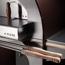 The ALFA 4 PIZZE outdoor pizza oven with optional sleek stainless steel bottom cart holds all your pizza making accessories easily