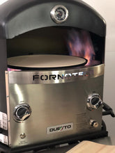 The Duetto Dual Burner Turntable Gas Fired Pizza Oven by Fornoteca features dual sided gas burners for optimum heat, doming and performance.