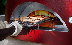 Great Outdoor Pizza Ovens food inserted into red Alfa Allegro outdoor wood-fired pizza oven