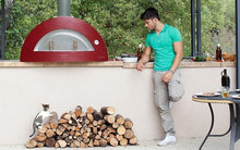 Great Outdoor Pizza Ovens man standing near red Alfa Allegro outdoor wood-fired pizza oven