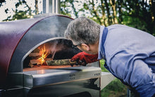 Stoking up the wood fire akes only 20 minutes to achieve ideal heating time in the ALFA 4 PIZZE outdoor pizza oven