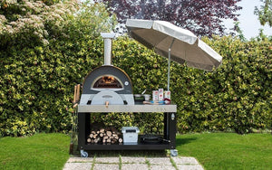 ALFA - CIAO Wood Fired Outdoor Pizza Oven with multi-functional cart makes an ideal outdoor kitchen (umbrella not included)