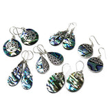 collection of silver and abalone earrings