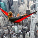 chilling out in a  hammock over a city