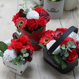 red soap flowers in pot