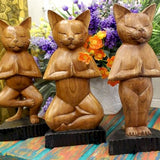 wooden cat in yoga pose