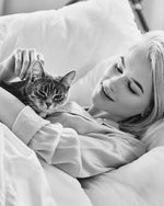 woman with cat and silk pyjamas