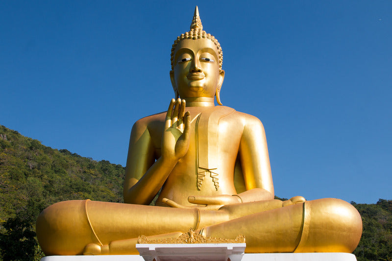gold colored buddha statue