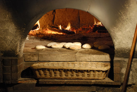 bread baking in a brick oven