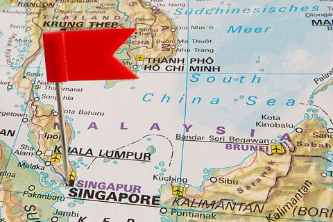 flag pin on map showing Singapore