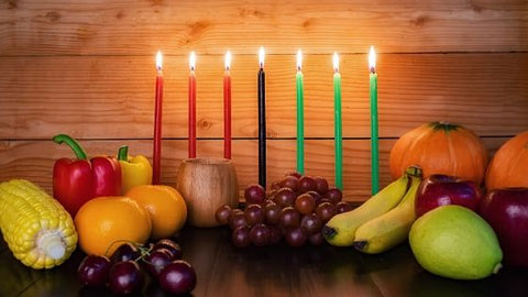 Kwanzaa candles and harvest vegetables
