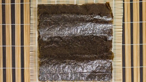 sheet of nori on sushi mat eat2explore