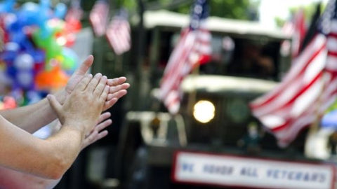 hands clapping at patriotic parade united states