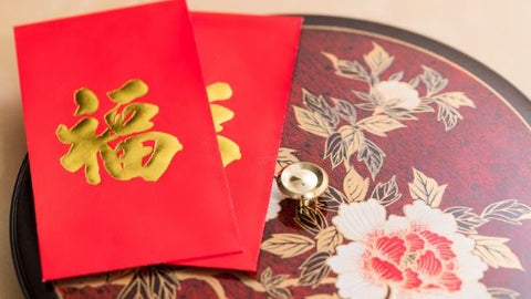 Chinese New Year red envelopes on table