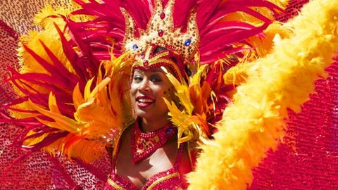 woman in pink and yellow feather costume Rio Carnival