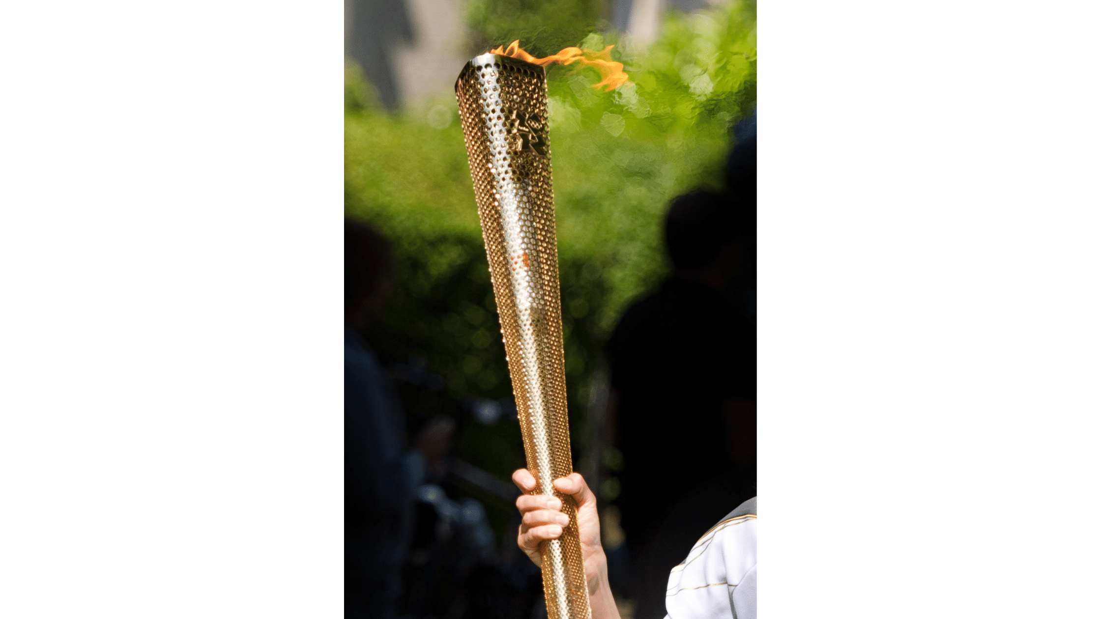 Olympic torch relay person holding torch