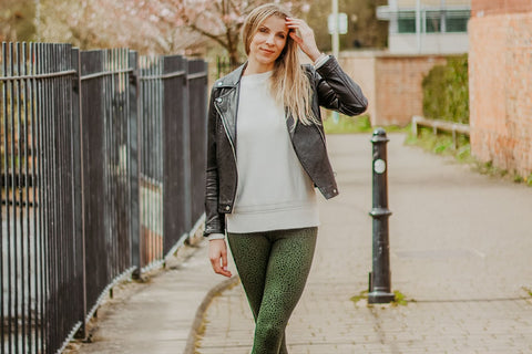 Green dapple leggings styled with a leather jacket