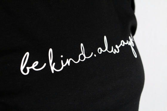 Black and white be kind always tee close up.