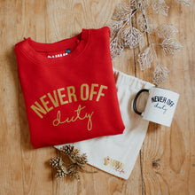 Never Off Duty cherry red and gold sweater and mug