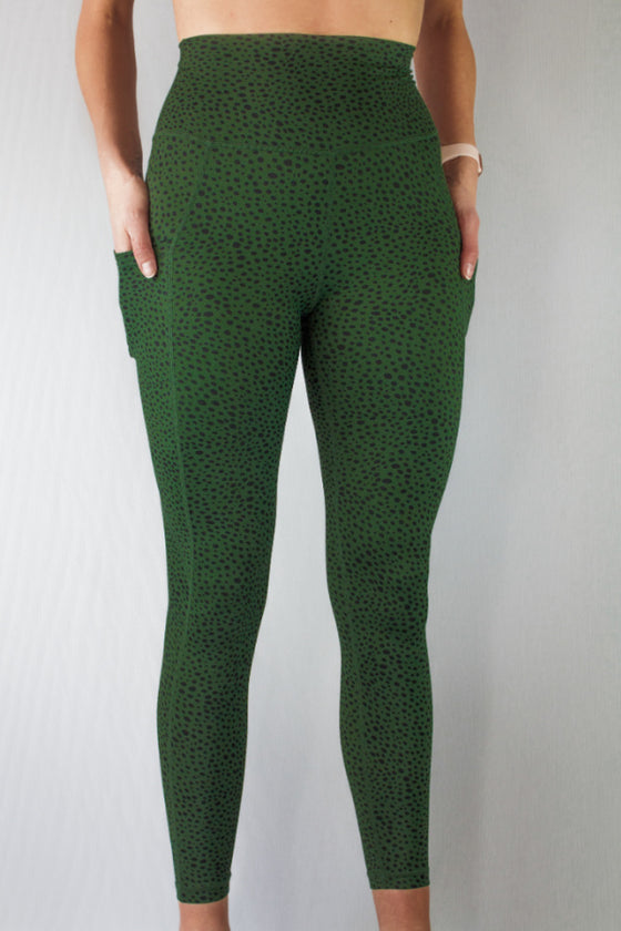 Front of green dapple leggings by Mama Life London