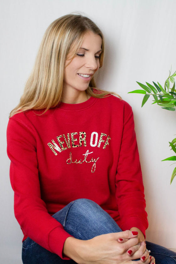 Cherry red Never Off Duty sweatshirt with leopard print slogan