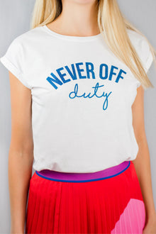 Never Off Duty white tee with blue glitter lettering.