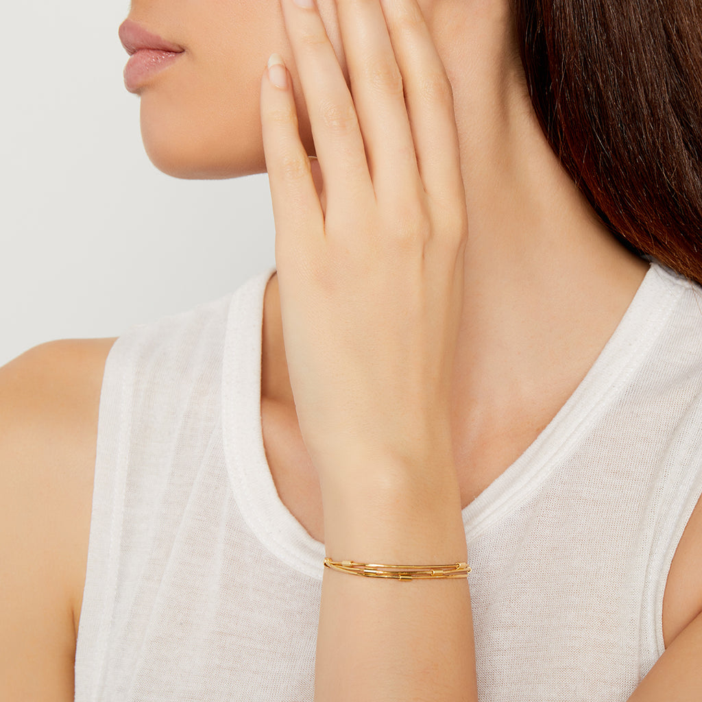 THE MULTI-LAYERED ADJUSTABLE BRACELET