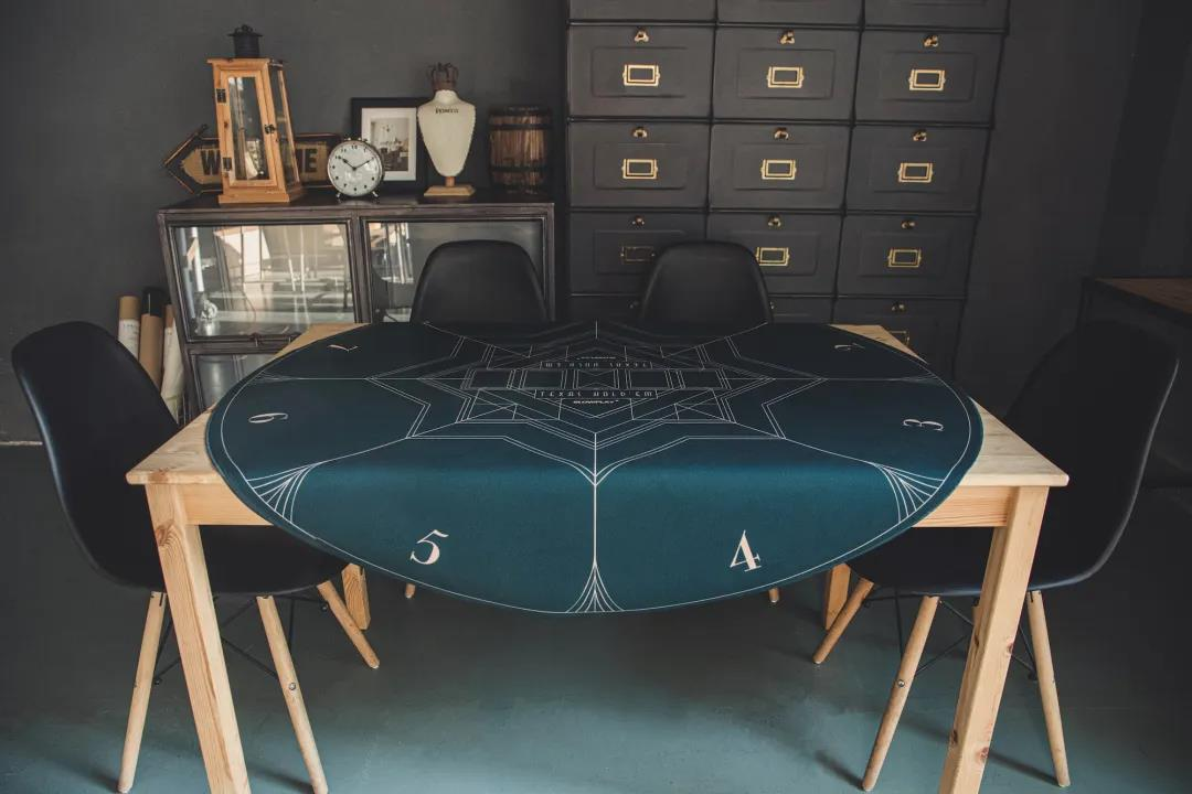 rich graphics inspired by Art Deco Design are featured in SLOWPLAY's Nash Poker Mat