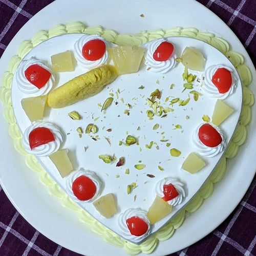 Eggless Pineapple Rasmalai Heart Cake - LayerBite