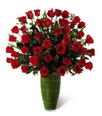 150 Red long roses in a vase with greenery