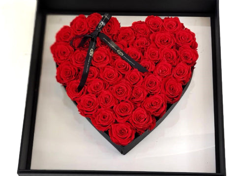 Luxurious Heart of 68 Red Preserved roses in a clear box